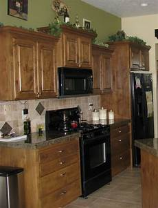green wall paint brown wooden kitchen cabinet and beige tile backsplash in 2019 green