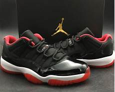air 11 low bred black and varsity white for