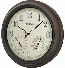 illuminated outdoor metal wall clock rubbed bronze dusk to