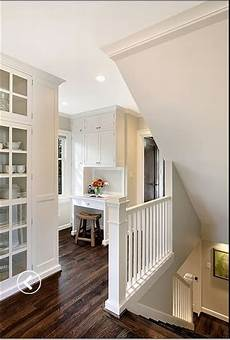 white walls and in floor storage make this creative house design white walls hardwood floors interior inspiration