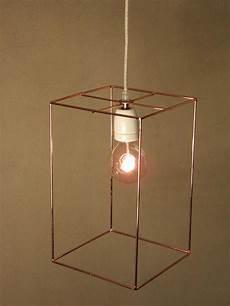 minimal custom handmade elongated rectangular cage pendant