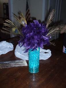 centerpiece trials for peacock themed evening wedding