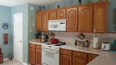 repainted my kitchen benjamin s homestead green to go with my honey oak cabinets kitchen
