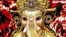 lighting ganesh ji wallpaper sri ganesha ganapati ganesh in light rays royal background wallpaper 1366x768