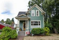 victorian home in seafoam green exterior house colors victorian homes blue green paints