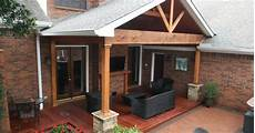 hardwood deck and gable roof patio cover with ledgestone half columns and tongue and groove