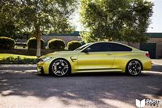yellow f82 m4 getting low with kw v3 coilovers