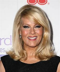 barbara niven medium straight formal hairstyle with side swept bangs golden blonde hair color