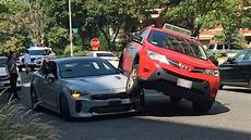 this sad kia stinger was squished by a toyota rav4 carscoops