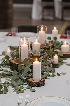picture of rustic centerpiece with greenery wood slices