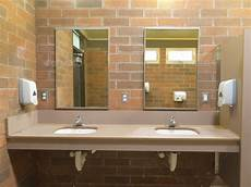simple clean public washroom sinks mirrors by pilens photodune
