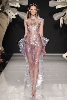 encased in plastic clear plastic dress with sculptural