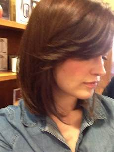a bob haircut with side bangs by yelp