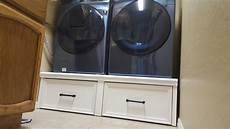 white washer dryer pedestal with flush front drawers