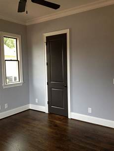 sherwin williams paint lazy gray on top and sherwin williams lazy gray and urbane bronze on doors and