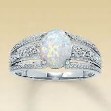 opal wedding ring i m kind of liking that it s unique not sure if i want to replace the