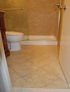 bathroom flooring ideas for small bathrooms tile on the diagonal on floor contrasted with smaller tiles placed on the shower wall