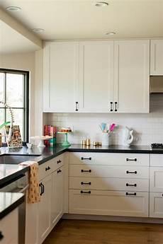 white kitchen cabinets with black hardware morespoons where to place hardware on kitchen cabinets