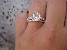 white gold engagement ring with a rose gold band