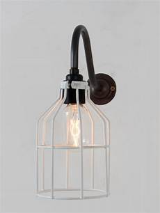 industrial style wall light finished with white sprayed metal cage