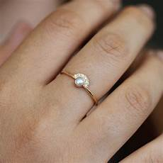 pearl engagement ring with half diamond halo artemer