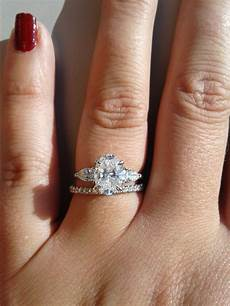 show me your wedding band with an oval engagement ring