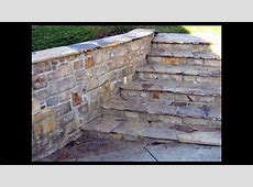 Outdoor Stone Fireplace and Beef Eater BBQ Grill in Custom