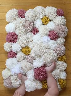pom pom rug is an easy diy you ll to try the whoot