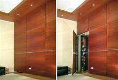 invisible doors turn a modern home into an artistic feat of secret spaces doors in paneled walls door