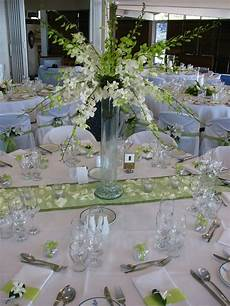 table setting green and white wedding decor at the royal