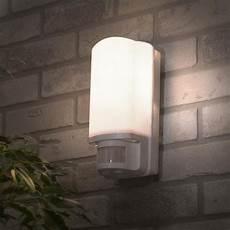 philips dakar outdoor wall light with security sensor white litecraft