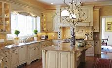 terrific french country kitchen decor with broken white cabinets and island combined with gold