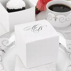 these large white wedding cake boxes allow your guests to take a sweet treat home with them