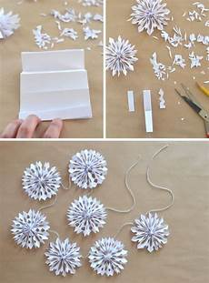 schneeflocken girlande basteln handmade paper snowflake garland