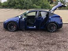 tesla model y doors first look at tesla model y power liftgate in action
