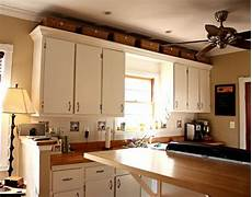 Ideas For Kitchen Above Cabinets by Baskets Above Kitchen Cabinets For The Home