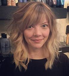 medium hairstyles with side fringe 40 styles featuring curly hair with bangs