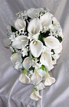 fiori a cascata white and blue cascading bridal bouquet orchids peonies
