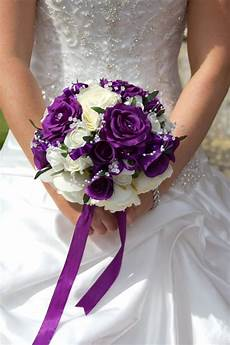purple and white bridal bouquet bridesmaids with deep