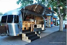 golf apparel on tour in an airstream and spartan pop up