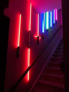 oh wow impressive lightsaber collection adorning staircase geekologie