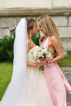 wedding day and bridesmaid fun after wedding ceremony happy marriage concept stock