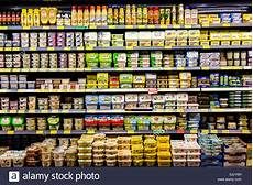 shelf with food in a supermarket milk products butter