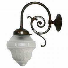 single victorian wall light in aged brass with etched glass shade