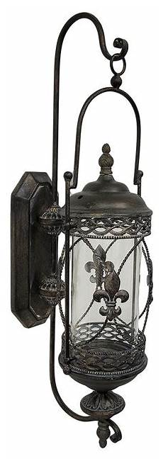 large rustic fleur de lis glass and metal hanging wall candle lantern traditional outdoor