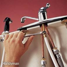 changing kitchen sink faucet replace a sink sprayer and hose the family handyman