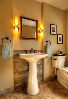 bathroom lighting ideas for small bathrooms troy lighting roxbury collection four light bath fixture pedestal sink bathroom powder room