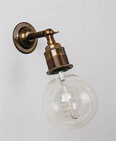 ned industrial style wall light from olive and the fox available in old brass bronze or