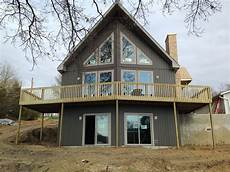 another lake home coming together lakefront waterfront home designs house design waterfront