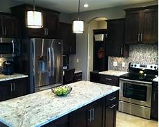 sw mega greige paint dark cabinets this is my wall color i hope it looks this good once my